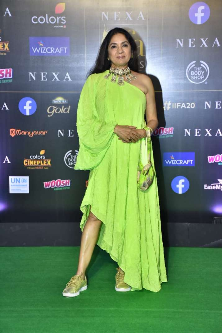 India Tv - Neena Gupta flaunts sneakers under neon green outfit,Neena Gupta is an Indian actress and television director.