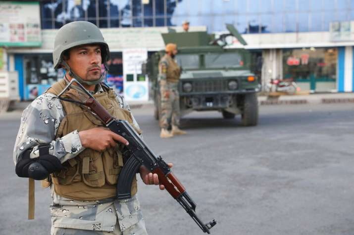 Afghan soldiers stand guard near a polling station in Kabul