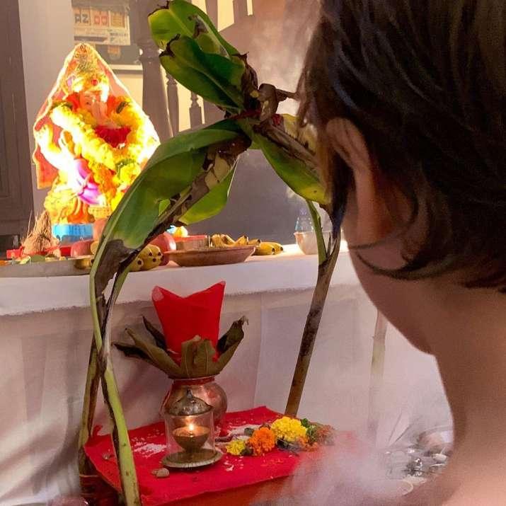 India Tv - Shah Rukh Khan's son AbRamdoing Ganesh puja before visarjan