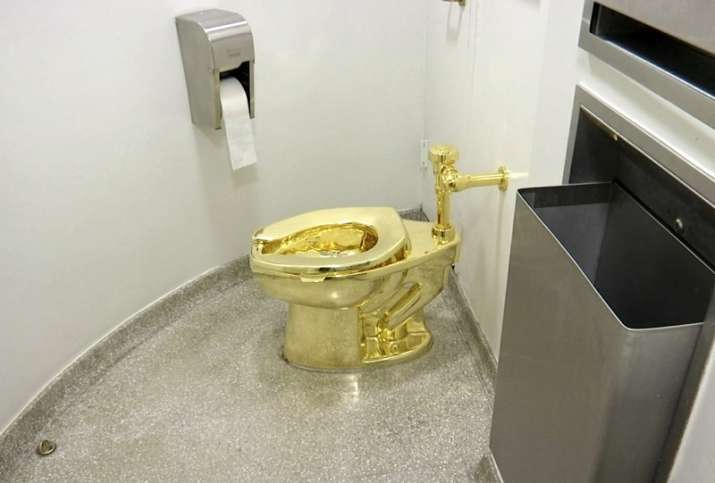 Solid gold toilet worth up to 1 million pounds stolen from