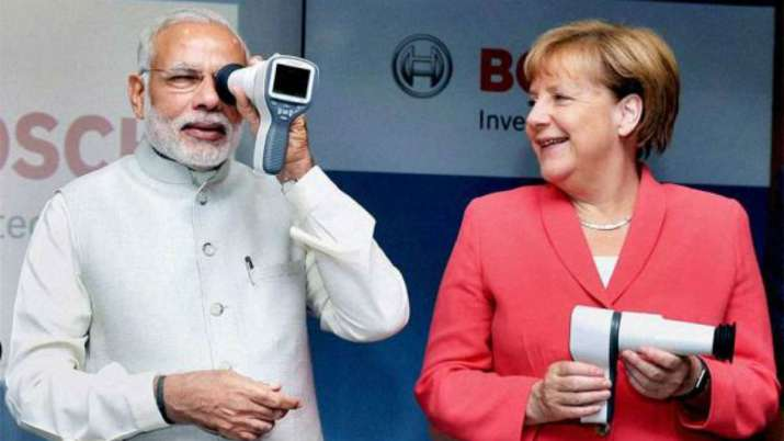 India Tv - PM Modi withGerman Chancellor Angela Merkel in Bengaluru