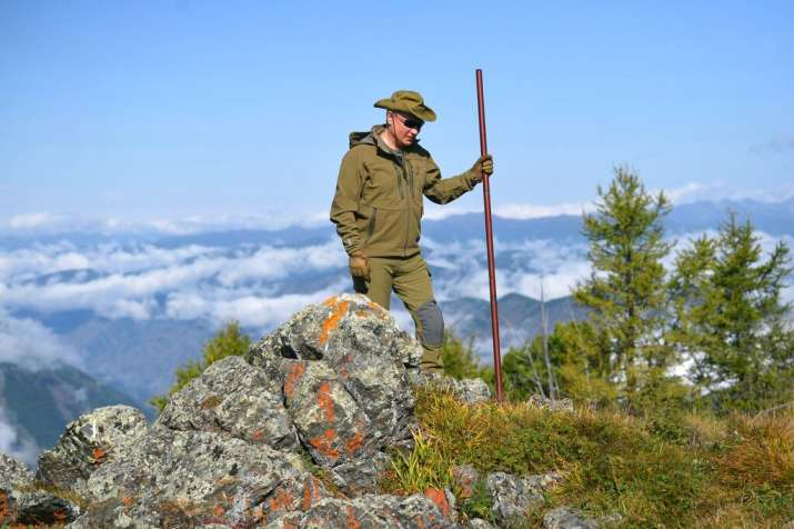 India Tv - Russian President Vladimir Putin poses for a photo on a hill in Siberia during a break from state affairs ahead of his birthday. Russian president chose the Siberian taiga forest to go on a hike ahead of his birthday on Oct. 7.