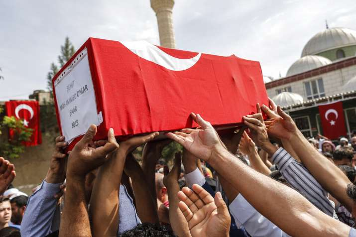 India Tv - Mourners carry the coffin of ten-month-old Mohammed Omar Saar, killed during incoming shelling from Syria Thursday.