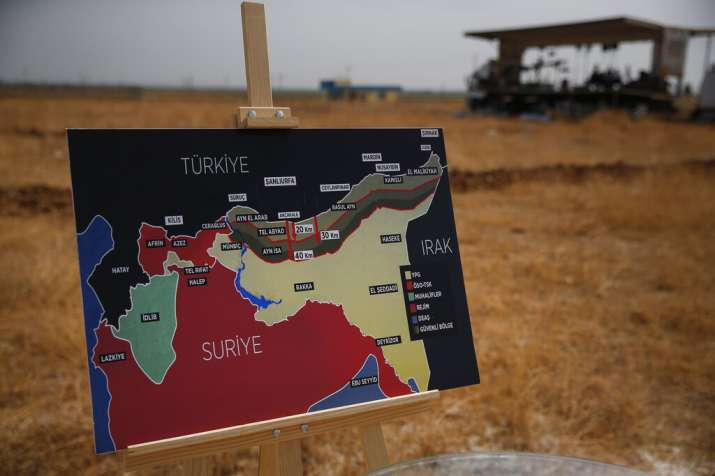 India Tv - A map showing Turkey's suggested operation in Syria, is placed to be used for a TV broadcast by journalists in Akcakale, Sanliurfa province, southeastern Turkey, at the border between Turkey and Syria, Friday, Oct. 11, 2019.