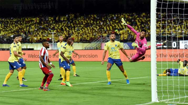 ATK team players score a goal during their match against