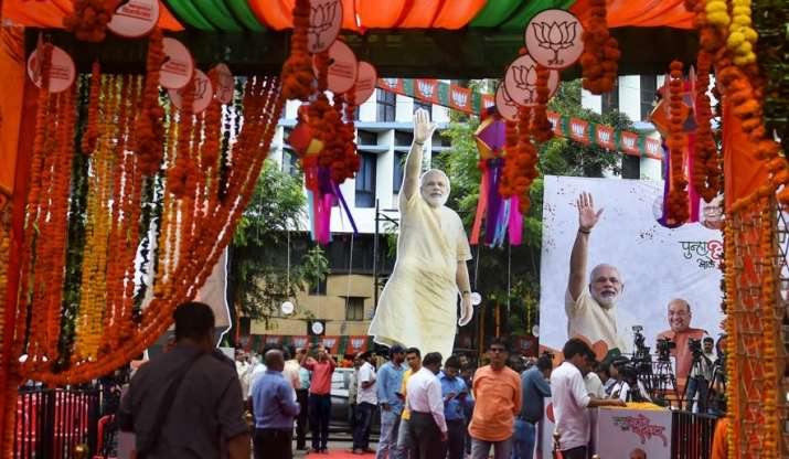 Party workers gather outside BJP office in Mumbai.