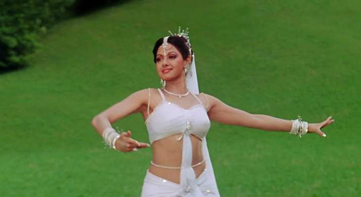 India Tv - In Chandni, Sridevi is a figure of idolised beauty -- whites, off whites and beige, the actress' look was a whole new rage in India: the Chandni look.