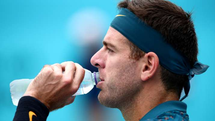 Juan Martin del Potro of Argentina takes a drink during his