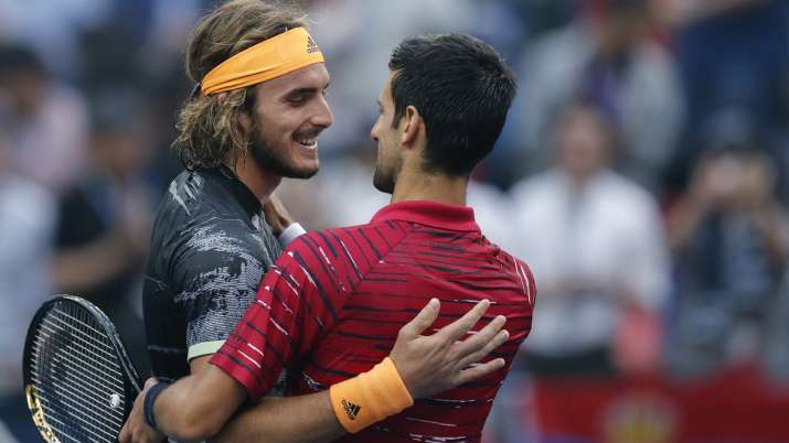 Stefanos Tsitsipas, left, of Greece is congratulated by