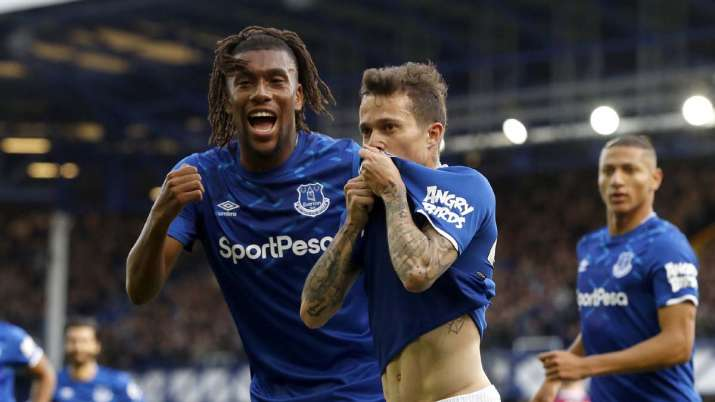 Everton's Bernard, centre, celebrates scoring his side's