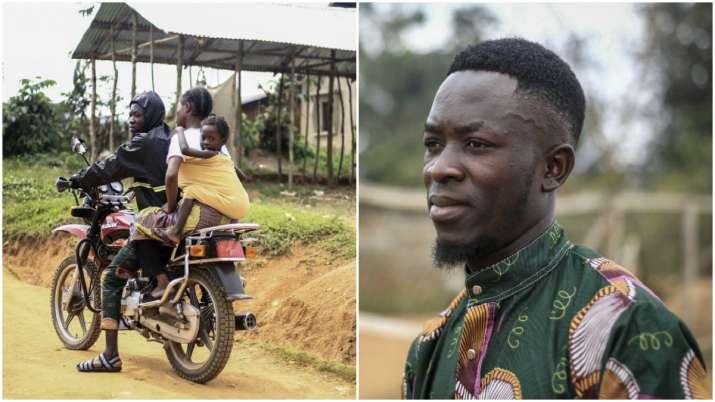 Ebola survivor with motorbike helps ease fear