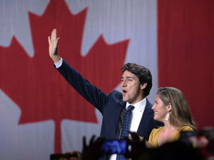 Liberal leader Justin Trudeau and wife Sophie Gregoire Trudeau wave as they go on stage at Liberal e