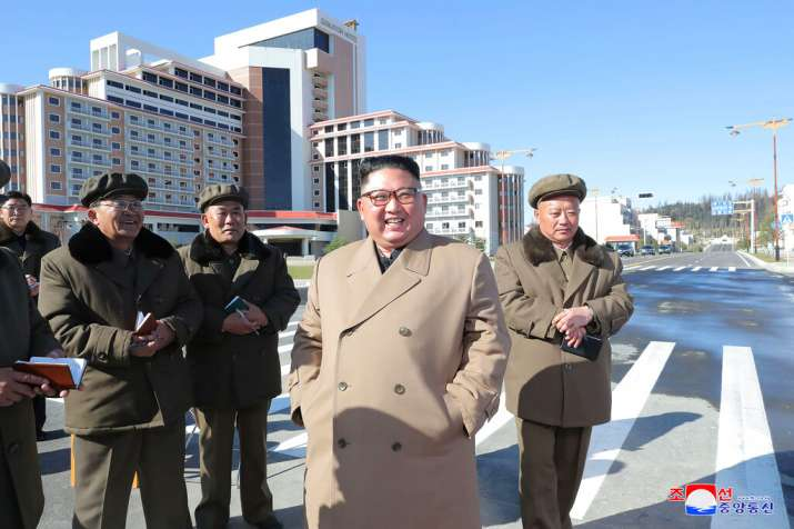 India Tv - Kim Jong Un, foreground, visits a construction site in Samjiyon County, North Korea.