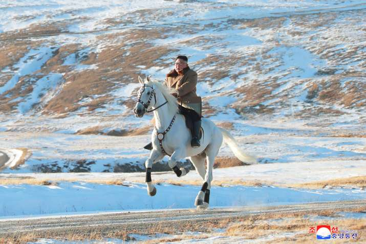 Kim Jong Un rides a white horse to climb Mount Paektu (AP)