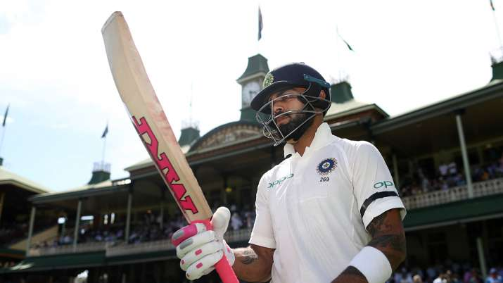 Virat Kohli of India walks out to bat during day one of the