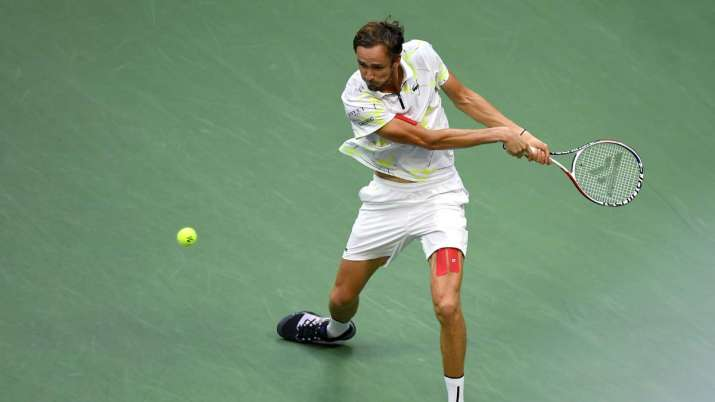 India Tv - Daniil Medvedev of Russia returns a shot during the fourth set of his Men's Singles final match against Rafael Nadal