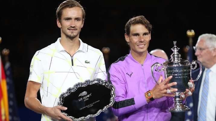 India Tv - Rafael Nadal (R) of Spain celebrates with the championship trophy alongside finalist Daniil Medvedev (L) of Russia during the trophy presentation ceremony after their Men's Singles final match on day fourteen of the 2019 US Open