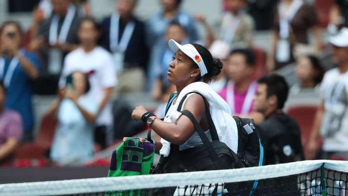 Naomi Osaka of Japan celebrates after defeating Alison