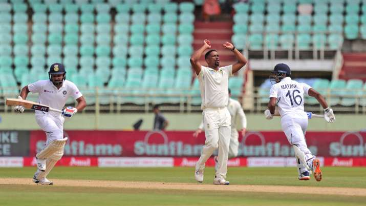 India Tv - India's Rohit Sharma, left, and Mayank Agarwal, right, run between the wickets during the first day of the first cricket test match against South Africa in Visakhapatnam