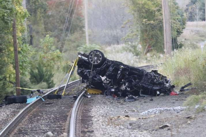 Porsche SUV plunges onto train tracks, burst into flames; 2