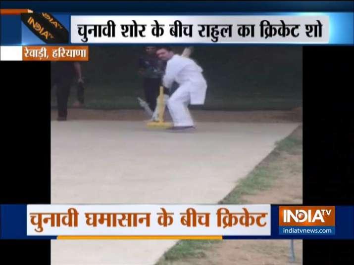 India Tv - Rahul Gandhi plays cricket with kids in Rewari