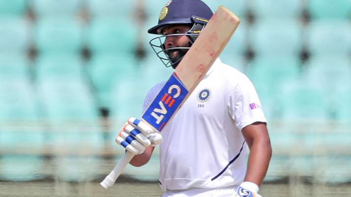 India's Rohit Sharma raises his bat after scoring fifty
