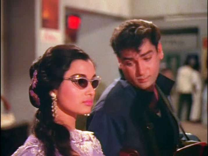 India Tv - In the early railway station and train sequence with Asha Parekh, he's a compulsive flirter to the point of being creepy.