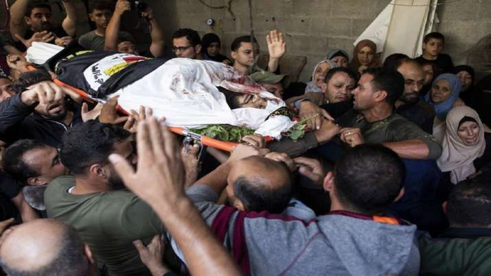 India Tv - Mourners carry the body of Islamic Jihad militant, Abdullah Al-Belbesi, 26, who was killed in Israel