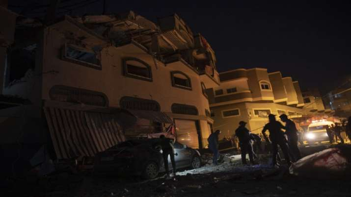 India Tv - Palestinians check the damage of a house targeted by Israeli missile strikes in Gaza City
