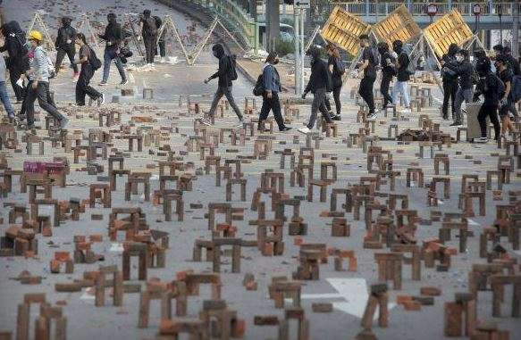 HK protests: 70-year-old dies after being hit by brick