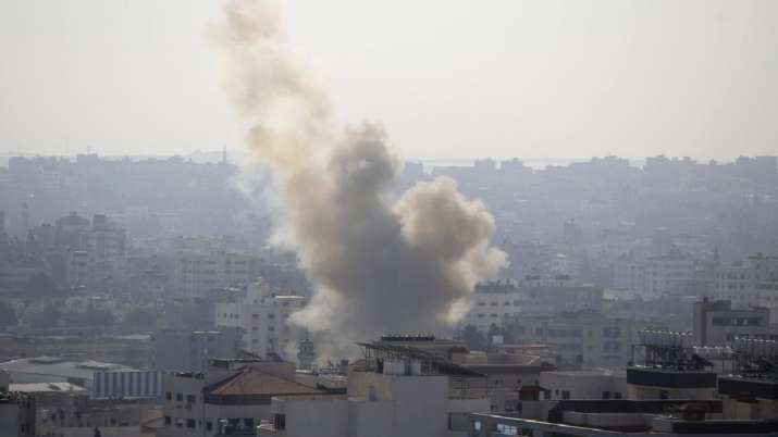 India Tv - Smoke rises after an Israeli forces strike in Gaza City