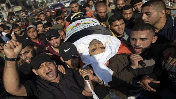 India Tv - Palestinians chant angry slogans as they carry the body of Islamic Jihad commander, Bahaa Abu el-Att