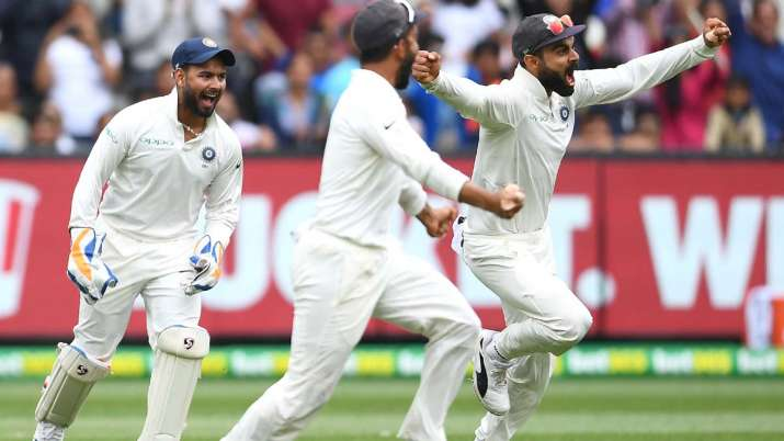 India Tv - Virat Kohli and his Indian team mates celebrate winning the test during day five of the Third Test match in the series between Australia and India at Melbourne Cricket Ground on December 30