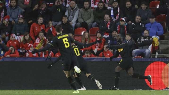 Inter Milan's Romelu Lukaku, right, celebrates with