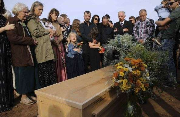 Last victim of Mexico border killings buried as others leave