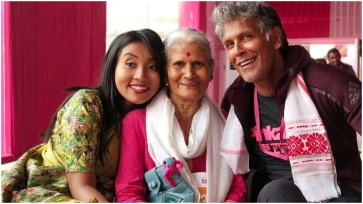 Milind Soman poses with mother Usha and wife Ankita Konwar