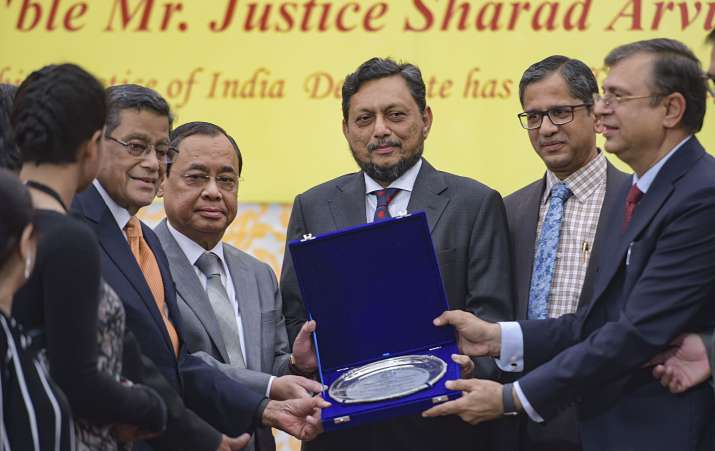 India Tv - CJI Ranjan Gogoi being presented with a memento on his retirement.