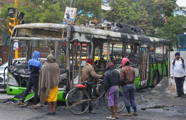 India Tv - Delhi: The bus that was charred yesterday allegedly by protestors of Citizenship Amendment Act.