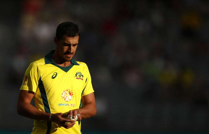 India Tv - Mitchell Starc has opined that in the absence of saliva to shine the ball, batsmen will be handed too much of an advantage