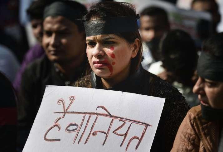 Protester wearing black band against rape and brutal murder