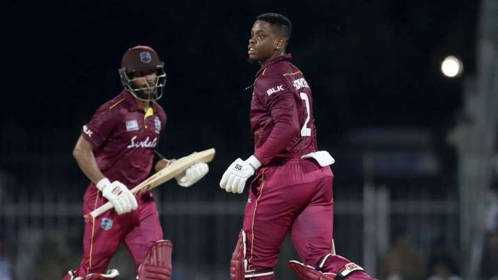 West Indies' and Shimron Hetmyer, right, and Shai Hope run