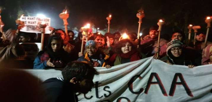 JNU students hold protests over police action in Jamia, AMU