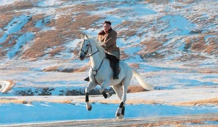 Kim Jong-un rides to sacred mountain on white horse