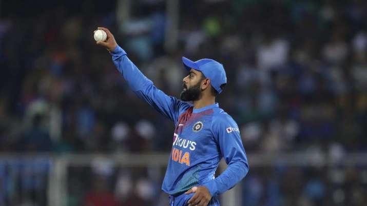 India's captain Virat Kohli gestures towards a teammate
