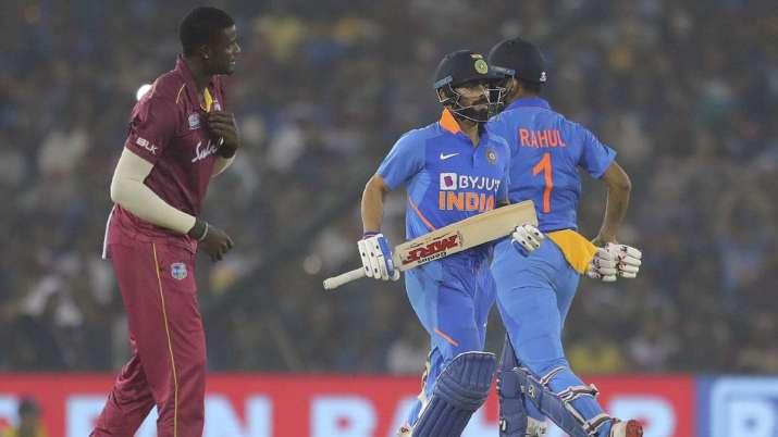 India's captain Virat Kohli , left, K L Rahul run between
