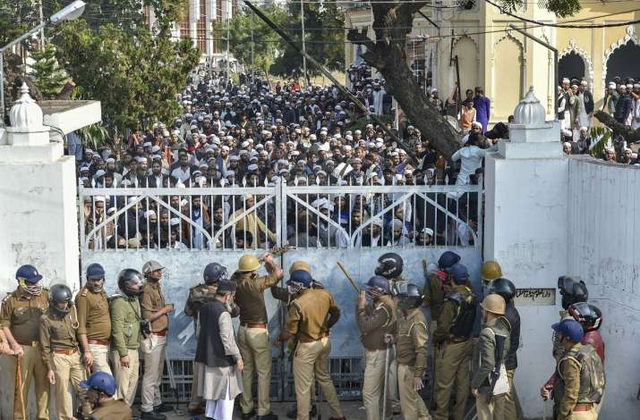 India Tv - Lucknow: Police force outside Darul Uloom Nadwatul Ulama college as students protest against the amended Citizenship Act and indulged in stone pelting.