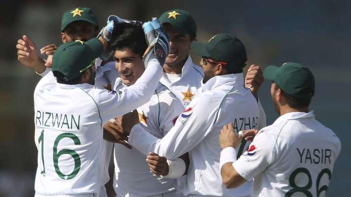Pakistani players greet Naseem Shah after the dismissal of