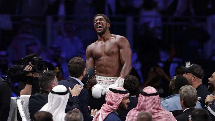 Britain's Anthony Joshua celebrates after beating Andy Ruiz