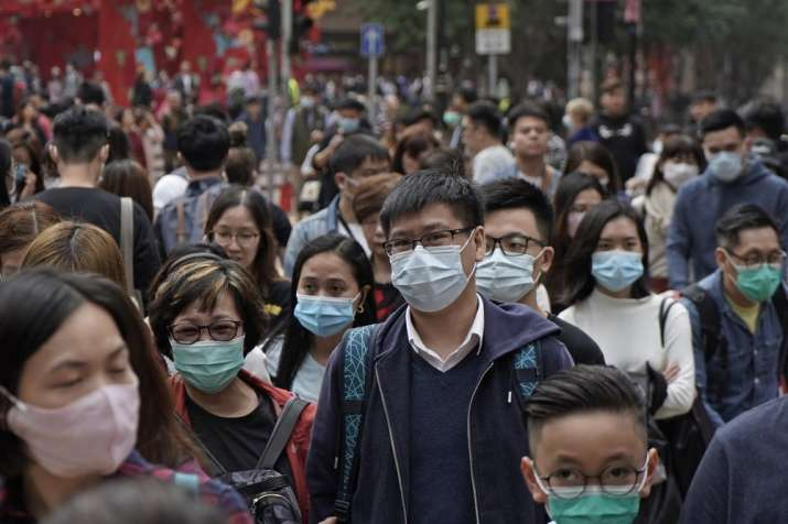 India Tv - People wear masks on a street in Hong Kong, Friday, Jan. 24, 2020 to celebrate the Lunar New Year wh