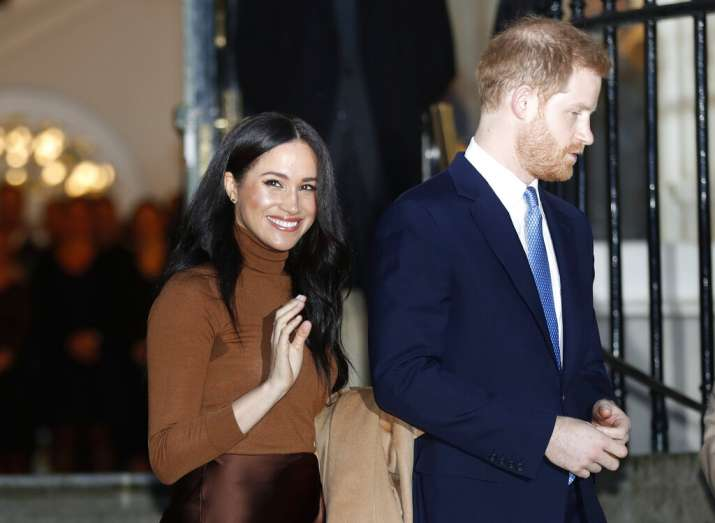 Prince Harry with wife Meghan Markle